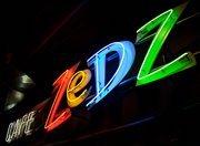 zedz cafe neon sign. red yellow blue green